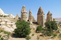 Love valley in Goreme village, Turkey. Rural Cappadocia landscape. Stone houses in Goreme, Cappadocia. Royalty Free Stock Image