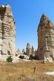 Love valley in Goreme village, Turkey. Rural Cappadocia landscape. Stone houses in Goreme, Cappadocia. Stock Photography