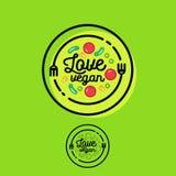 Love vegan logo. Cafe or restaurant emblem. Fork, spoon and vegetables. Royalty Free Stock Images