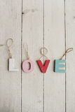 Love vintage letters on wooden background Stock Photos