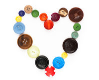 Love vintage - old buttons in a heart shape Royalty Free Stock Image