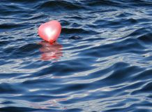 At Love Voyage... Baloon on the water surface Royalty Free Stock Photos