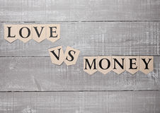 Love vs money paper letters symbol motivation sign Royalty Free Stock Images