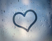 Love on wet glass. Sending a romance message on wet glass Royalty Free Stock Image