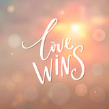 Love wins - insirational quote at sunrise background with bokeh.  Royalty Free Stock Photo