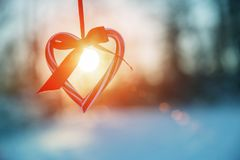 Love in winter. Heart shaped symbol Valentine Day. heart with hands, Feelings and Lifestyle concept on the sunset light royalty free stock image