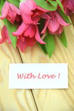 With love wishes and bouquet of gorgeous red tulips Stock Photography