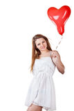 Love woman holding heart balloon Stock Photo