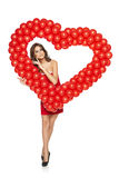 Love woman holding red heart shaped balloons Royalty Free Stock Photography