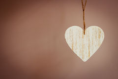 Love wooden heart hanging on texture background Stock Photography