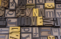 Love in wooden typeset. The word Love surrounded by random typeset Royalty Free Stock Photo