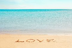 Love word. 'Love' word written on the beach near the sea Stock Images