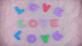 Love. Word Love appearing three times on the pink texture for background. Different color letters and pink background become red in the end on the clip stock video
