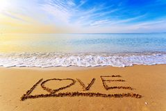 Beach. Drawing love word on beach Stock Photo