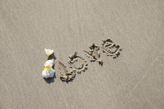 Love word on on the beach Royalty Free Stock Image