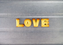 Love word, biscuit cookies letters Royalty Free Stock Photo