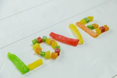 Love word with candied fruits stock photo