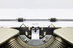 Love word in capital letters on white sheet Royalty Free Stock Images