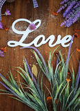 Love word card with retro wooden background and lavender Royalty Free Stock Images
