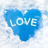 Love word cloud heart shape. Blue sky background only Royalty Free Stock Images