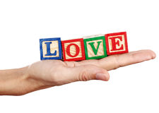 Love word in a hand Stock Image
