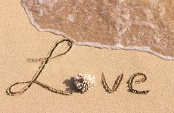 Love handwritten on the tropical beach royalty free stock image