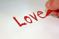 Love. The word love handwritten in red crayon Vector Illustration
