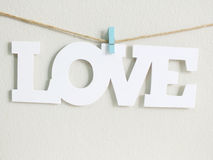 Love word hanging with rope Stock Images