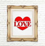 Love word and heart icon ( Saying love) in golden vintage photo frame on white brick wall,Love concept Royalty Free Stock Photos