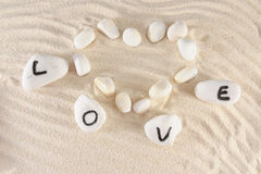 Love word and heart shape Stock Image