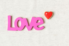 Love word and heart shaped cookie on linen background Royalty Free Stock Image