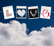 Love word made of four different objects Royalty Free Stock Image