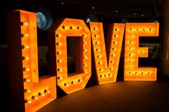 Glowing letters Love made of light bulbs. Love word made of glowing light bulbs. Copy space text Royalty Free Stock Photos