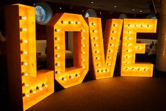 Glowing letters Love made of light bulbs. Love word made of glowing light bulbs. Copy space text Royalty Free Stock Image