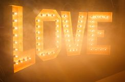 Glowing letters Love made of light bulbs. Love word made of glowing light bulbs. Copy space text Stock Photography