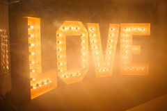 Glowing letters Love made of light bulbs. Love word made of glowing light bulbs. Copy space text Stock Images