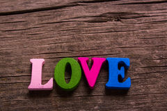 Love word made of wooden letters Stock Images