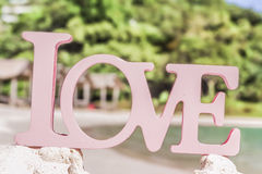 Love word on natural tropical background Stock Photos