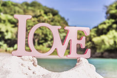 Love word on natural tropical background Royalty Free Stock Photography