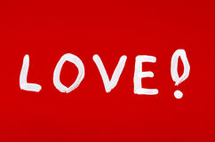 Love word painted over red Royalty Free Stock Photo