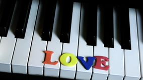 Love Word on piano key. And Candles stock footage