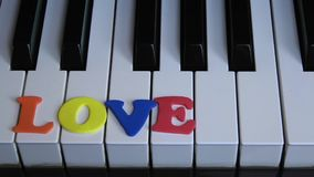Love Word on piano key. Video stock footage