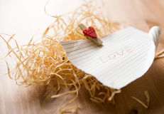 Love word on piece of paper Royalty Free Stock Photos