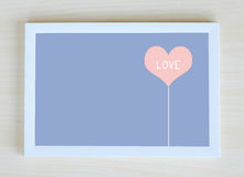 Love word on pink heart shape in white frame Stock Images