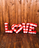Love word of plush red letters on wood corner Stock Photography