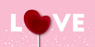 Love word with red lollipop heart card. Royalty Free Stock Photo
