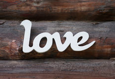 Love word in retro style on wooden background. Concept Royalty Free Stock Image