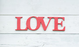 Love word in retro style on wooden background. Concept Stock Photography