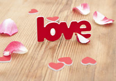 Love word and rose petal Royalty Free Stock Photography