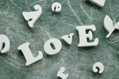 Love word. Love sign on green wooden background stock image